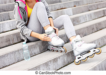 Woman putting on roller-blades - A picture of a woman...