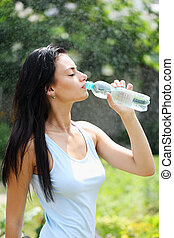 Woman quenches thirst