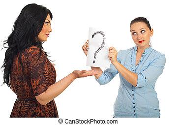 Woman questioning her friend - Brunette woman questioning...