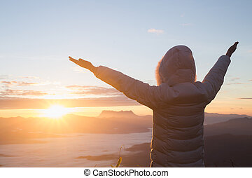 woman raise their arms up the sky, Thank God, the morning sunrise background, Christian Religion concept background.