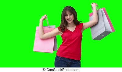 Woman raising shopping bags