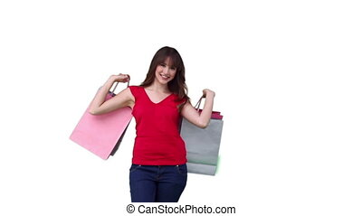 Woman raising shopping bags which she is holding