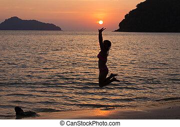 Woman reaching the sun