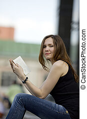 Woman read book and look at you