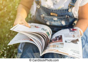 reading a magazine blur