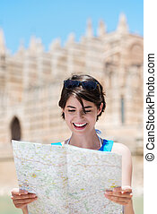 Woman reading a map while on holiday