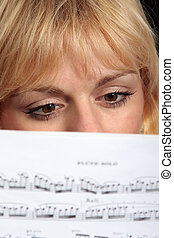 Woman reading a music score