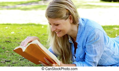 Woman reading a novel in a park