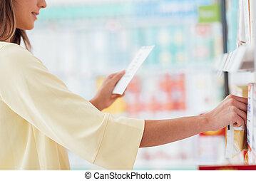 Woman reading a shopping list