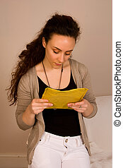 woman reading address on a letter.