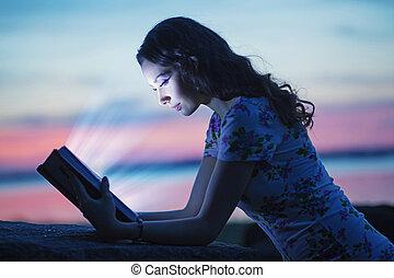 Woman reading an interesting book - Pretty woman reading an...
