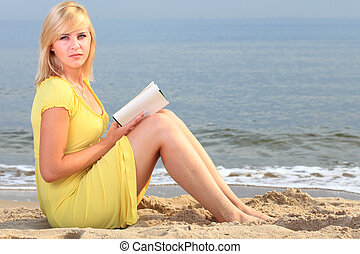woman reading book girl yellow dress