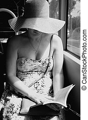 Woman reading ebook on train bus