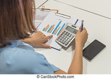 Woman reading financial report