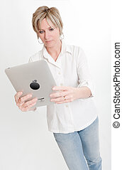 Woman reading from a PC tablet
