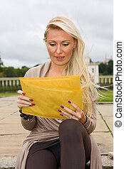 woman reading her post.