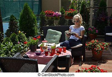 Woman Reading in a Garden