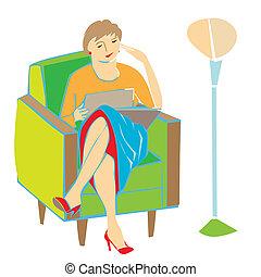 woman reading on armchair