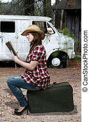 Woman Reading on Suitcase