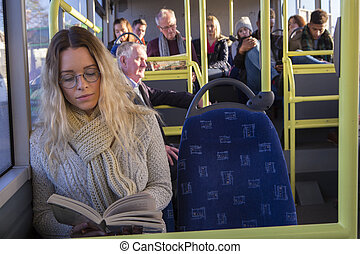 Woman reading on the bus