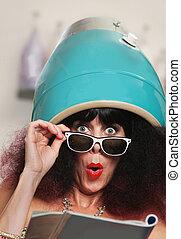 Woman Reading Under Hair Dryer