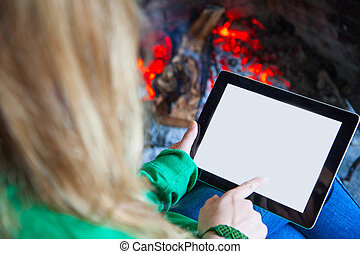 Woman reading with tablet