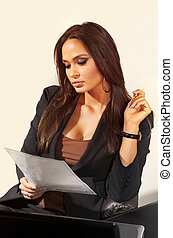 woman reads business document
