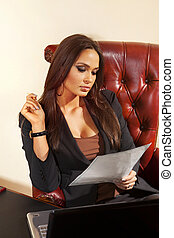 woman reads document at office