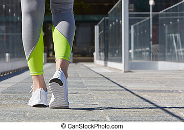 Woman ready to run in the city in a sunny day