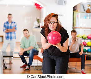 Woman Ready With Bowling Ball in Club