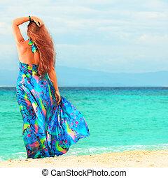 Woman - Rear view of woman near the sea