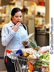 Woman receipt checked at the supermarket