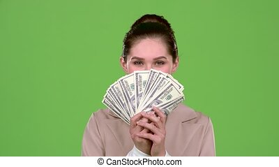 Woman received paper money for a major deal. Green screen. Slow motion