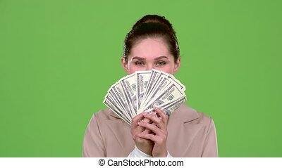 Woman received paper money for a major deal. Green screen