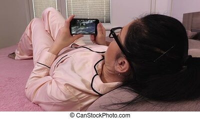 Woman received video message on smartphone