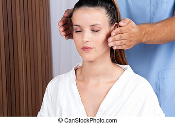 Woman Receiving a Face Massage