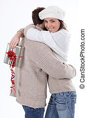 Woman receiving a gift from her boyfriend