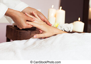Woman receiving a hand massage at the health spa