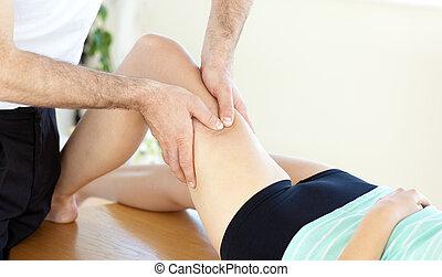 woman receiving a leg massage