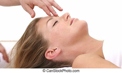 Woman receiving a massage in the head