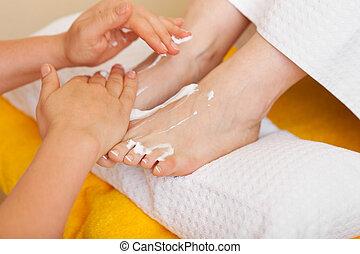Woman receiving a pedicure