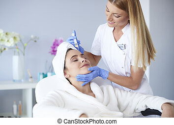Woman receiving botox injection in clinic