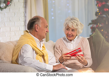 Woman receiving Christmas gift