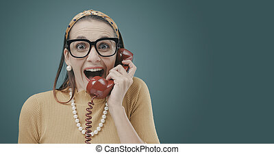 Woman receiving great news on the phone
