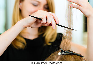 Woman receiving haircut - Woman at the hairdresser, she is ...