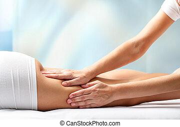 Woman receiving leg massage. - Therapist massaging upper...