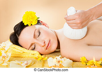 Woman Receiving Massage With Herbal Compress Stamps At Spa -...
