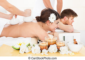 Woman Receiving Massage With Herbal Compress Stamps -...