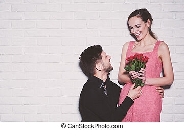 Woman receiving roses from boyfriend - Happy young woman...