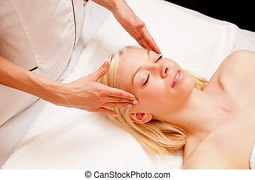Woman Receiving Spa Massage - Portrait of a woman in a spa...